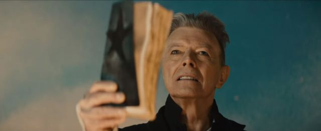Bowie now with his eyes open as his new self and his book looks into the light